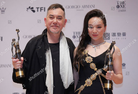 "Chloe Maayan, Anthony Wong. Chinese actress Chloe Maayan, right, and Hong Kong actor Anthony Wong pose after winning the Best Actress and Best Actor of their movie ""Three Husbands"" and movie ""Still Human"" at the Hong Kong Film Awards in Hong Kong"