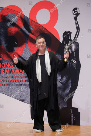 "Hong Kong actor Anthony Wong poses after winning the Best Actor of his movie ""Still Human"" at the Hong Kong Film Awards in Hong Kong"