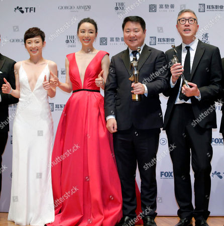 "Stock Photo of Felix Chong, Yu Dong, Zhang Jingchu, Catherine Chau. From right, Hong Kong director Felix Chong, Chinese film producer Yu Dong, Chinese actress Zhang Jingchu and Hong Kong actress Catherine Chau pose after winning the Best Director and Best Film for the movie ""Project Gutenberg"" at the Hong Kong Film Awards in Hong Kong"