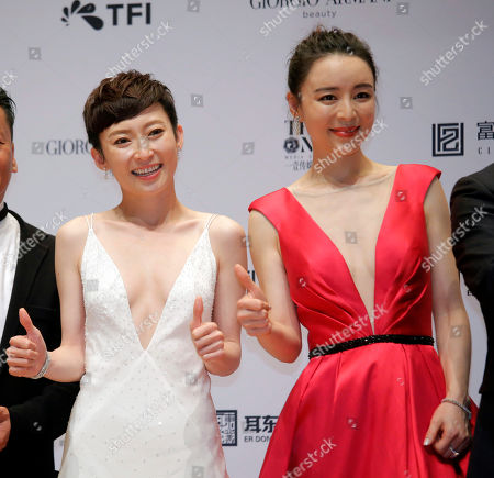 "Zhang Jingchu, Catherine Chau. Chinese actress Zhang Jingchu, right and Hong Kong actress Catherine Chau pose after winning the Best Director and Best Film for the movie ""Project Gutenberg"" at the Hong Kong Film Awards in Hong Kong"