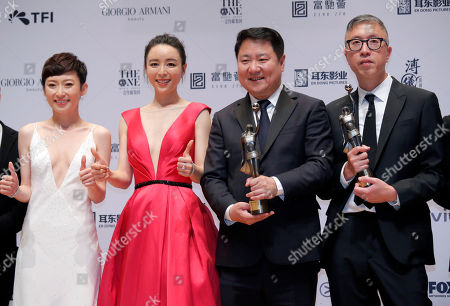 "Stock Image of Felix Chong, Yu Dong, Zhang Jingchu, Catherine Chau. From right, Hong Kong director Felix Chong, Chinese film producer Yu Dong, Chinese actress Zhang Jingchu and Hong Kong actress Catherine Chau pose after winning the Best Director and Best Film for the movie ""Project Gutenberg"" at the Hong Kong Film Awards in Hong Kong"