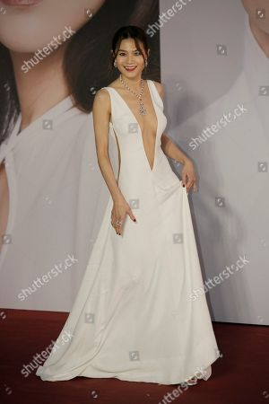Stock Image of Hong Kong actress Chrissie Chau poses with his wife on the red carpet of the Hong Kong Film Awards in Hong Kong