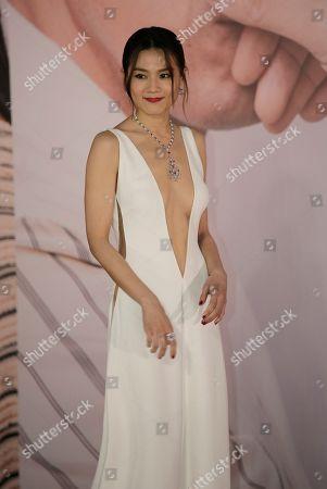 Hong Kong actress Chrissie Chau poses on the red carpet of the Hong Kong Film Awards in Hong Kong