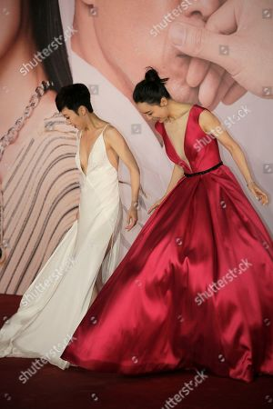 Stock Picture of Zhang Jingchu, Catherine Chau. Chinese actress Zhang Jingchu, right, and Hong Kong actress Catherine Chau pose on the red carpet of the Hong Kong Film Awards in Hong Kong