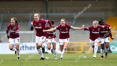Claire Rafferty of West Ham United Women celebrateswith team-mates after winning penalty  shoot-out