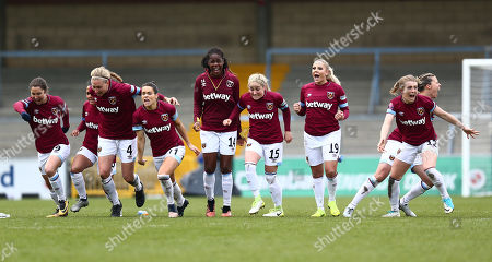 Claire Rafferty of West Ham United Women celebrates with team-mates after winning penalty  shoot-out