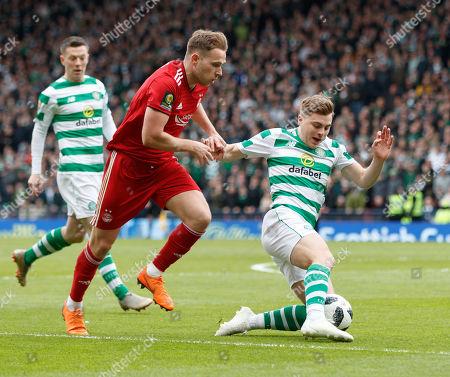Greg Stewart of Aberdeen challenges James Forrest of Celtic