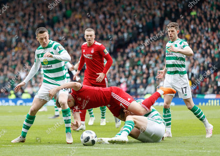 Greg Stewart of Aberdeen fights for the ball with James Forrest of Celtic