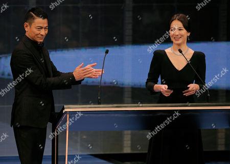 Andy Lau, Song Hye-kyo. Hong Kong actor Andy Lau, left, and South Korean actress Song Hye-kyo, right, gesture at the Hong Kong Film Awards in Hong Kong