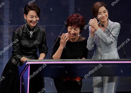 Kara Wai, Paw Hee-ching, Teresa Mo. Hong Kong actress, from left, Kara Wai, Paw Hee-ching and Teresa Mo react at the Hong Kong Film Awards in Hong Kong
