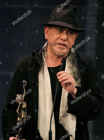 "Stock Photo of Hong Kong actor Anthony Wong speaks after winning the Best Actor of his movie ""Still Human"" at the Hong Kong Film Awards in Hong Kong"
