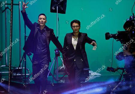 Nicholas Tse, Daniel Wu. Hong Kong actor Nicholas Tse, right, and Daniel Wu walk to the stage at the Hong Kong Film Awards in Hong Kong