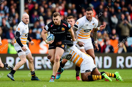 Luke Cowan-Dickie of Exeter Chiefs is tackled by Ashley Johnson of Wasps
