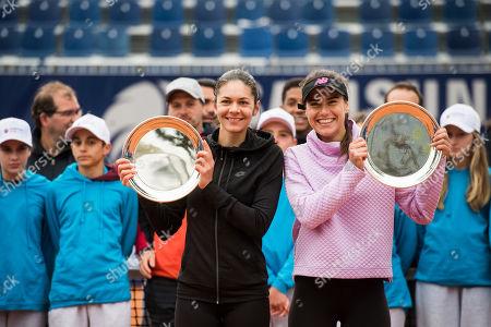 Romania's Andreea Mitu, left, and Sorana Cirstea, pose after winning the double final against Russia's Veronika Kudermetova and Kazakhstan's Galina Voskoboeva at the Wilcards Samsung Open 2019 WTA tennis turnament in Lugano, Switzerland, Sunday, April 14, 2017.