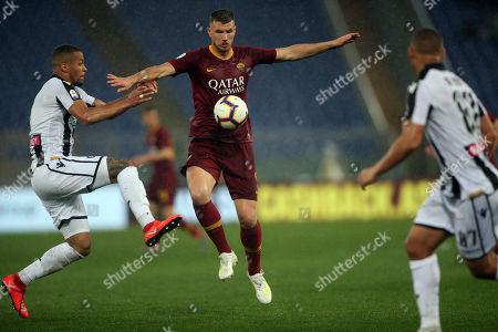 William Troost-Ekong of Udinese and Edin Dzeko of Roma