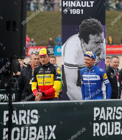 Winner Philippe Gilbert of Belgium, right, and his third place teammate Yves Lampaert of Belgium, left, walk towards the podium of the 117th edition of the Paris-Roubaix cycling classic, a 257 kilometer (160 mile) one-day-race, with about 20 per cent of the distance over cobblestone roads, at the velodrome in Roubaix, northern France