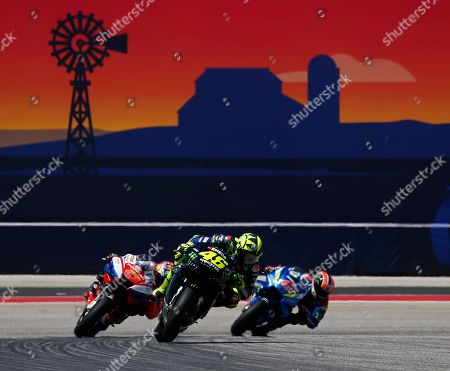 Team Suzuki Ecstar Team rider Alex Rins of Spain (R), Alma Pramac Racing Team rider Jack Miller of Australia (L), and Monster Energy Yamaha MotoGP Team rider Valentino Rossi of Italy (C) in action during the MotoGP Race at the Red Bull Grand Prix of the Americas at Circuit of the Americas in Austin, Texas, USA, 14 April 2019.