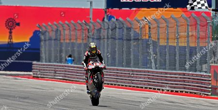 Stock Photo of Dynavolt Intact GP Team rider Tom Luthi of Switzerland crosses the finish line in first place during the Moto2 Race at the Red Bull Grand Prix of the Americas at Circuit of the Americas in Austin, Texas, USA, 14 April 2019.