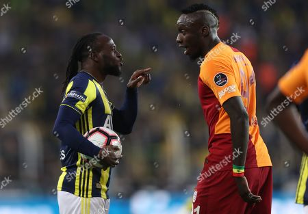 Fenerbahce's Victor Moses (L) argues with Galatasaray's Mbaye Diagne (R) during the Turkish Super League soccer match between Fenerbahce and Galatasaray, in Istanbul, Turkey, 14 April 2019.