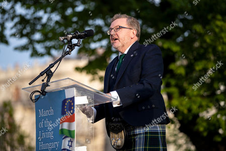 British Secretary of State for Scotland David Mundell speaks during the 17th March of the Living commemoration held for the Hungarian victims of the Holocaust in downtown Budapest, Hungary, 14 April 2019.
