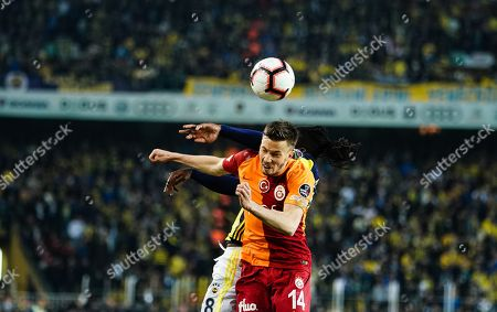 Victor Moses of Fenerbache tackling Martin Linnes of Galatasaray with a elbow during the Turkish Super Lig match between Fenerbache and Galatasaray at the Åžükrü SaracoÄŸlu Stadium in Istanbul , Turkey