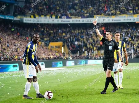 Victor Moses of Fenerbache getting a yellow card during the Turkish Super Lig match between Fenerbache and Galatasaray at the Åžükrü SaracoÄŸlu Stadium in Istanbul , Turkey