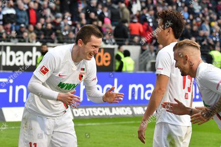 of  Jonathan Schmid #17 (FC Augsburg), Michael Gregoritsch #11 (FC Augsburg) and Ja-Cheol Koo #19 (FC Augsburg)  1:3, Eintracht Frankfurt vs. FC Augsburg, Football, 1.Bundesliga, 14.04.2019, DFL REGULATIONS PROHIBIT ANY USE OF PHOTOGRAPHS AS IMAGE SEQUENCES AND/OR QUASI-VIDEO