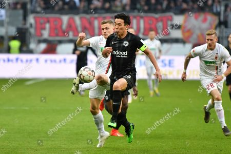 Alfred Finnbogason #27 (FC Augsburg) and Makoto Hasebe #20 (Eintracht Frankfurt), Eintracht Frankfurt vs. FC Augsburg, Football, 1.Bundesliga, 14.04.2019,