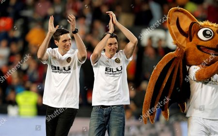 British actors James Phelps (R) and Oliver Phelps (L) participate in the kick off shot before the Spanish LaLiga soccer match between Valencia CF and UD Levante at Mestalla stadium, Valencia, eastern Spain, 14 April 2019.