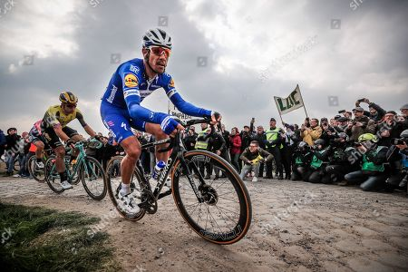 Deceuninck Quick Step team rider Philippe Gilbert of Belgium in action on a cobblestone section during the 117th Paris Roubaix cycling race, France, 14 April 2019.