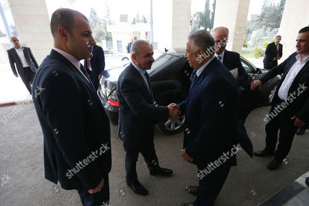 Stock Image of Newly Palestinian Prime Minister Mohammad Shtayeh meets with former Prime Minister Rami Hamdallah