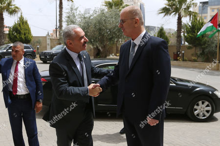 Stock Photo of Newly Palestinian Prime Minister Mohammad Shtayeh meets with former Prime Minister Rami Hamdallah