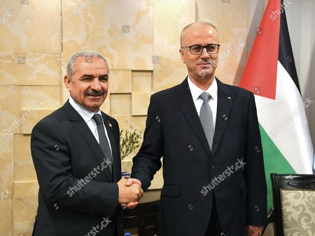 Newly Palestinian Prime Minister Mohammad Shtayeh meets with former Prime Minister Rami Hamdallah