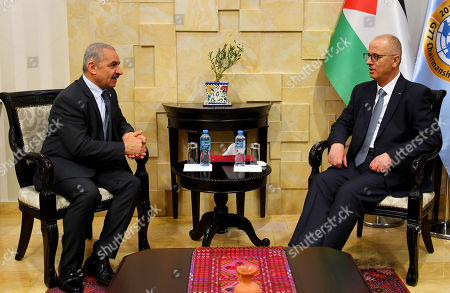 Stock Picture of Newly Palestinian Prime Minister Mohammad Shtayeh meets with former Prime Minister Rami Hamdallah