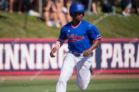 Louisiana Tech's Mason Robinson scores a run during an NCAA college baseball game against FAU, in Boca Raton, Fla