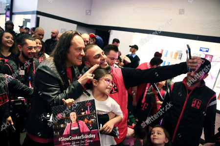 T-Mobile's CEO John Legere filming Slow Cooker Sunday at T-Mobile Signature Store on in Chicago