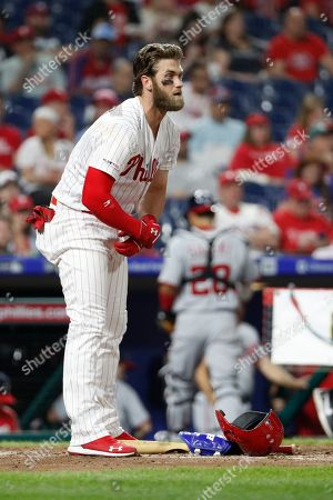 Philadelphia Phillies' Bryce Harper looks on after striking out during the third inning of a baseball game against the Washington Nationals, in Philadelphia. Phillies won 4-3