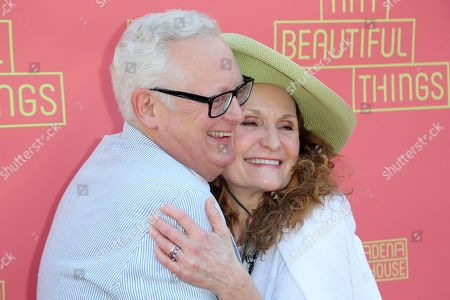 """Michael Chieffo, Beth Grant. Michael Chieffo, left, and Beth Grant hug as they arrive at the opening night of """"Tiny Beautiful Things"""" at the Playhouse Pasadena, in Pasadena, Calif"""