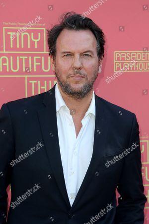 """Jay Huguley arrives at the opening night of """"Tiny Beautiful Things"""" at the Playhouse Pasadena, in Pasadena, Calif"""