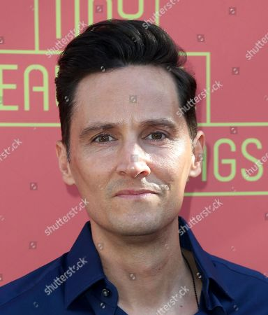 """Christian Barillas arrives at the opening night of """"Tiny Beautiful Things"""" at the Playhouse Pasadena, in Pasadena, Calif"""