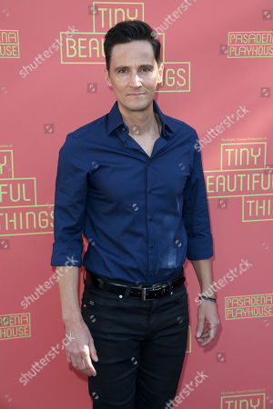 """Stock Picture of Christian Barillas arrives at the opening night of """"Tiny Beautiful Things"""" at the Playhouse Pasadena, in Pasadena, Calif"""