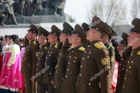 Soldiers pay tribute to the statues of former leaders Kim Il Sung and Kim Jong Il on Mansu Hill to mark the Day of the Sun in Pyongyang