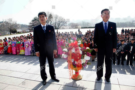 People visit with flowers to pay tribute to the statues of former leaders Kim Il Sung and Kim Jong Il on Mansu Hill to mark the Day of the Sun in Pyongyang