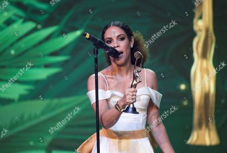 Stock Image of Judith Rodriguez receives an award for Best Dramatic Actress for her role in the film 'Cocote' during the IRIS Dominicana Movie Awards, in Santo Domingo, Dominican Republic, 14 April 2019.