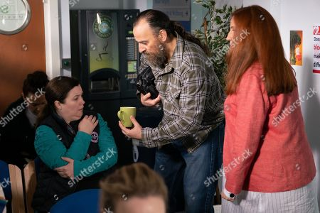 Ep 9754 Friday 26th April 2019 - 1st Ep As Mary Taylor, as played by Patti Clare, loads up the flower shop van, Jan, as played by Piotr Baumann, cycles round the corner and crashes into her injuring her wrist. Moira, as played by Louisa Patikas, and Jan help Mary into the medical centre.