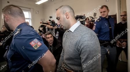 Arash Nahvi is escorted by police for his court proceedings at the Municipal Court in Prague, Czech Republic, 15 April 2019. The prosecutor accused two Dutch men, Armin and Arash Nahvi, from a group of seven men, of attempted murder. Seven Dutch men were arrested in Prague for allegedly assaulting a waiter in the center of the city on 21 April 2018. According to media reports, the men were caught on CCTV video footage attacking a waiter, who told them they could not drink their own alcohol while sitting on the cafe terrace. The assaulted waiter was in intensive care at a hospital, where he was treated with brain hemorrhage, broken facial bones and an injured eye.