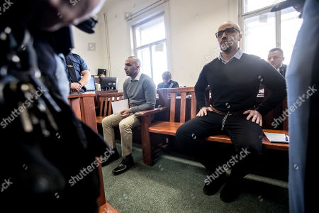 Armin Nahvi (R) and Arash Nahvi (L) wait for start of court proceedings at the Municipal Court in Prague, Czech Republic, 15 April 2019. The prosecutor accused two Dutch men, Armin and Arash Nahvi, from a group of seven men, of attempted murder. Seven Dutch men were arrested in Prague for allegedly assaulting a waiter in the center of the city on 21 April 2018. According to media reports, the men were caught on CCTV video footage attacking a waiter, who told them they could not drink their own alcohol while sitting on the cafe terrace. The assaulted waiter was in intensive care at a hospital, where he was treated with brain hemorrhage, broken facial bones and an injured eye.