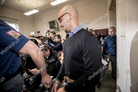 Armin Nahvi is escorted by police for his court proceedings at the Municipal Court in Prague, Czech Republic, 15 April 2019. The prosecutor accused two Dutch men, Armin and Arash Nahvi, from a group of seven men, of attempted murder. Seven Dutch men were arrested in Prague for allegedly assaulting a waiter in the center of the city on 21 April 2018. According to media reports, the men were caught on CCTV video footage attacking a waiter, who told them they could not drink their own alcohol while sitting on the cafe terrace. The assaulted waiter was in intensive care at a hospital, where he was treated with brain hemorrhage, broken facial bones and an injured eye.