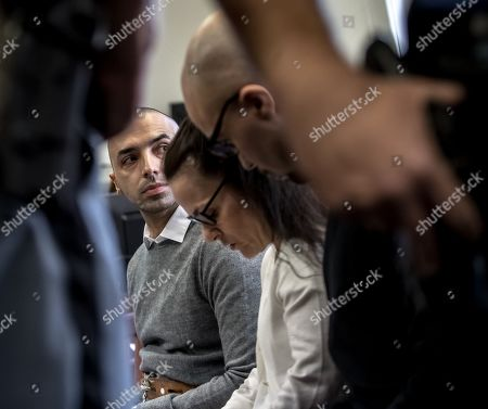 Armin Nahvi (R) and Arash Nahvi (L) wait for start of court proceedings, with a translator (C), at the Municipal Court in Prague, Czech Republic, 15 April 2019. The prosecutor accused two Dutch men, Armin and Arash Nahvi, from a group of seven men, of attempted murder. Seven Dutch men were arrested in Prague for allegedly assaulting a waiter in the center of the city on 21 April 2018. According to media reports, the men were caught on CCTV video footage attacking a waiter, who told them they could not drink their own alcohol while sitting on the cafe terrace. The assaulted waiter was in intensive care at a hospital, where he was treated with brain hemorrhage, broken facial bones and an injured eye.