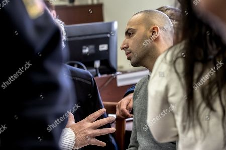 Arash Nahvi waits for start of court proceedings at the Municipal Court in Prague, Czech Republic, 15 April 2019. The prosecutor accused two Dutch men, Armin and Arash Nahvi, from a group of seven men, of attempted murder. Seven Dutch men were arrested in Prague for allegedly assaulting a waiter in the center of the city on 21 April 2018. According to media reports, the men were caught on CCTV video footage attacking a waiter, who told them they could not drink their own alcohol while sitting on the cafe terrace. The assaulted waiter was in intensive care at a hospital, where he was treated with brain hemorrhage, broken facial bones and an injured eye.